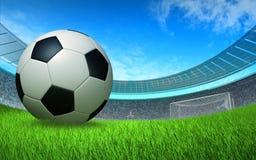Dichte omhooggaand van de voetbalbal voor de poort bij het stadion Royalty-vrije Stock Afbeeldingen