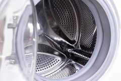 Dichte omhooggaand van de wasmachinetrommel, wasserijconcept royalty-vrije stock foto's