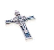 Dichte omhooggaand van het kruisbeeld geïsoleerdo op witte achtergrond Stock Afbeelding