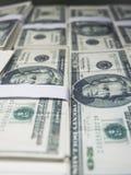 Dichte omhooggaande de Muntzaken van de dollarstapel Stock Afbeeldingen