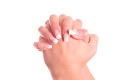 Dichtgeklemde geïsoleerde handen. Stock Fotografie