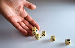 Dicing. The hand of the person throwing cubes for dicing royalty free stock photo