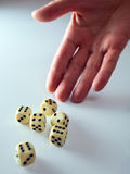 Dicing. The hand of the person throwing cubes for dicing royalty free stock image
