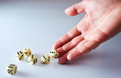 Dicing. The hand of the person throwing cubes for dicing royalty free stock images