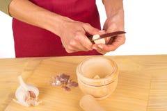 Dicing garlic Royalty Free Stock Photography
