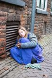 Dickens festival  Christmas carol people cold girl at a wall. Dickens festival characters Christmas carol every year in Deventer, with different characters. men Stock Images