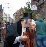 Dickens festival  Christmas carol people drunken husband and wife Royalty Free Stock Photos