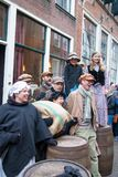 Dickens festival  Christmas carol people sing at old wine barrels. Dickens festival characters Christmas carol every year in Deventer, with different characters Royalty Free Stock Images