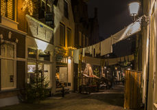 Dickens Festival Menstraat. Deventer, The Netherlands - December 17, 2016: Menstraat street in Deventer during Christmas time in the evening with christmas Royalty Free Stock Images