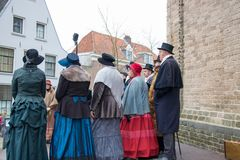 Dickens festival people singing Christmas carol. Dickens festival characters Christmas carol every year in Deventer, with different characters. men and women who Royalty Free Stock Photos