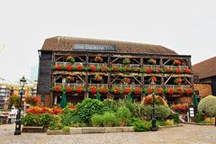 Pretty Dickens Inn house and garden London England royalty free stock photography