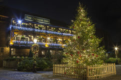The Dickens Inn Public House in London at Christmas. A view of The Dickens Inn Public House at situated in St. Katherine Docks in London during Christmas Stock Photo