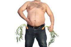 Dicker Mann, der Karotte hält Lizenzfreies Stockbild