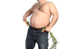 Dicker Mann, der Karotte hält Lizenzfreie Stockbilder