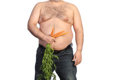 Dicker Mann, der Karotte hält Stockfoto