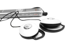 Dictaphone and headphones Stock Photos