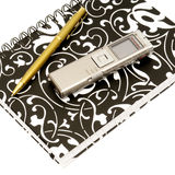 Dictaphone, notepad and ballpen on white. Background Stock Images