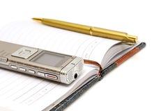 Dictaphonen notepad och ballpen royaltyfri fotografi