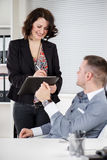 Dictating. Happy Business people Working together in the office. Manager with his secretary. He is dictating something to her Stock Image
