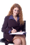 Dictation. Beautiful Redhead as a secretary taking notes or a college student Stock Photography