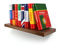 Dictionaries on bookshelf white  backgound. Royalty Free Stock Image