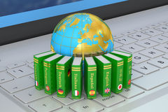Dictionaries with Globe on the laptops keyboard.  Stock Photos