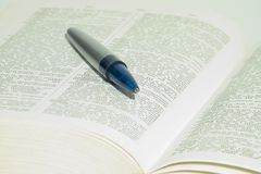 Dictionary. A book and a pen Royalty Free Stock Photo