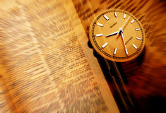 Dictionary with clock. Close-up of old dictionary with clock Stock Photo