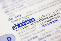 Dictionary definition of word decrease in blue Stock Image
