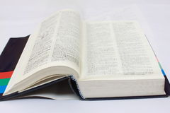 Dictionary on desk Stock Photography