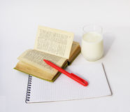 Dictionary and glass of milk Stock Photos