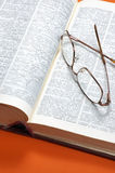 Dictionary and glasses Stock Photography