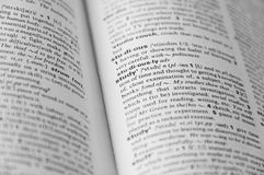 Dictionary page with word in focus. Dictionary page with word study in focus and other is defocused Royalty Free Stock Photos