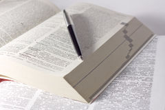 Dictionary with a pen Royalty Free Stock Images