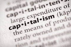 Dictionary Series - Economics: capitalism. Selective focus on the word capitalism. Many more word photos for you in my portfolio Stock Image