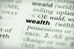 Dictionary Series - Economics: wealth. Selective focus on the word wealth Royalty Free Stock Image