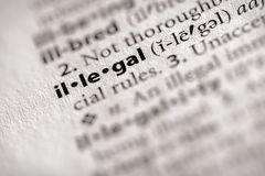 Dictionary Series - Law: illegal. Selective focus on the word illegal. Many more word photos for you in my portfolio Royalty Free Stock Photos
