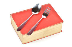 Dictionary and tableware Royalty Free Stock Photos