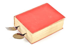Dictionary and tableware. On white background Stock Photography