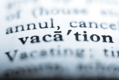 Dictionary word. Vacation close up with blue tint and differential focus Stock Photography