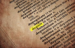 Dictionary word. Deport word in old textured dictionary Stock Photos
