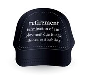 Dictionary word of retirement on baseball cap Royalty Free Stock Images