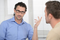 Dicussing options. Two confident business people dicussing busin Stock Photo