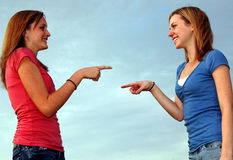 She did it. Two teenage girls/sisters pointing at each other Royalty Free Stock Photography
