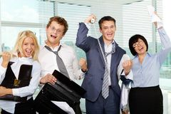 We did it. Group of tired businesspeople showing gladness after making excellent deal Stock Image