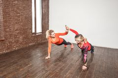We did it! Best friends doing pilates each other. Studio shot stock photos