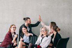 We did it business team result corporate. We did it. Business team result. Excited young corporate employees relaxing. Copy space on grey background royalty free stock photography