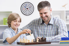 When did he get so smart?. Shot of a little boy playing chess with his dad Stock Photos