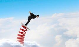 He did great career jump. Businessman jumping on springboard as progress concept Stock Photos