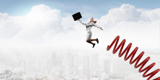 She did great career jump. Businesswoman jumping on springboard as progress concept Royalty Free Stock Photo